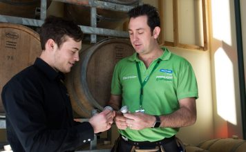 Director of Kamberra Function Centre Lachlan Exton with an ActewAGL installer